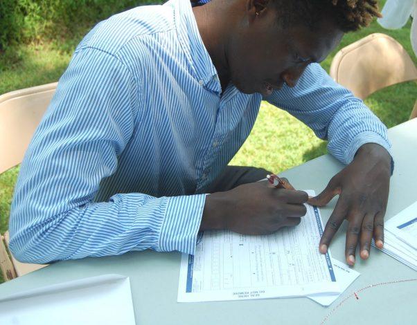 Hussane Yarra completing his Voters' Registration form